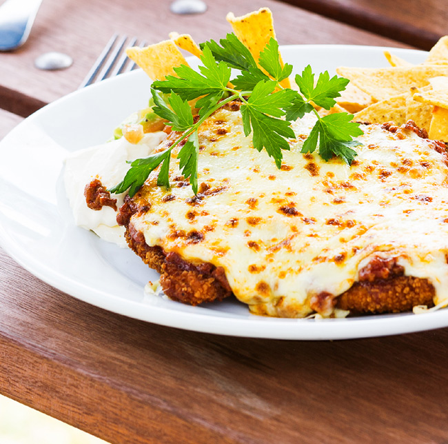 Chicken Parmigiana at Tradies Helensburgh's Flame Tree Grill